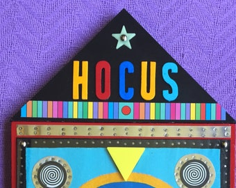 HOCUS FOCUS - Recycled Mixed Media Assemblage on Wood
