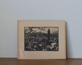 Vintage wood cut gothic city scene with trees illustration