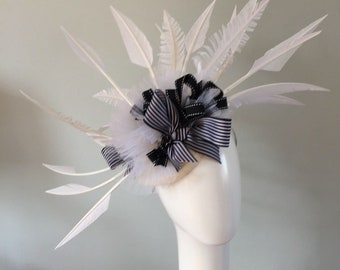 Black and white large stunning headpiece with pretty striped ribbon, hand cut feathers  WOW factor