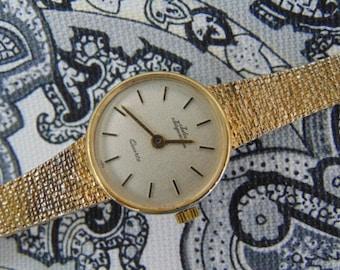 Ladies Jules Jurgensen Swiss Quartz Integrated Band Watch, Gold tone.