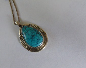 Sterling silver and turquoise Navajo Pendant and chain signed ST.