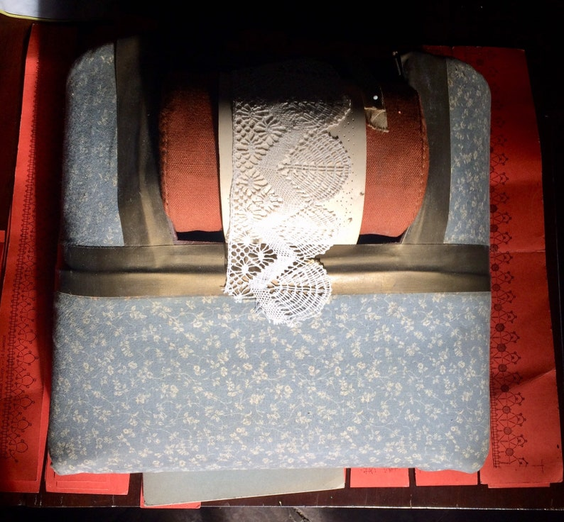 Vintage bobbin lace making cushion with bobbins