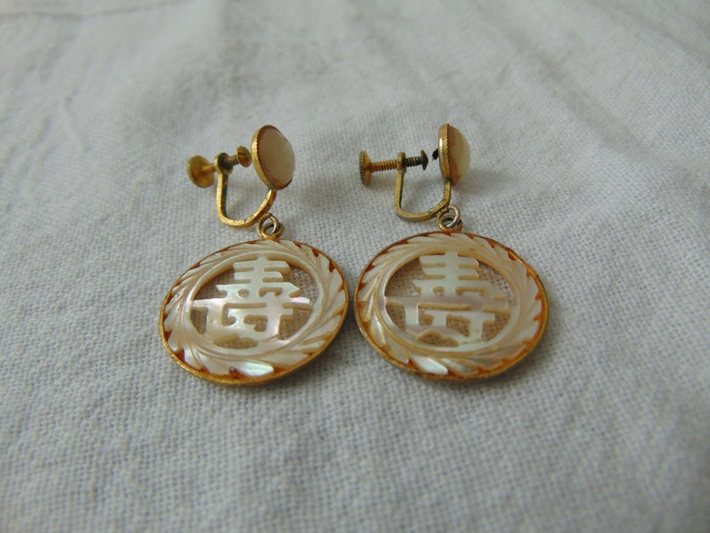 vintage mother of pearl chinese good luck gold filled screwback earrings carved dangles