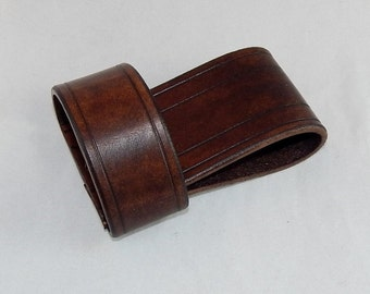 Hand made leather belt loop tool hanger for tomahawk, hatchet, hammer; Made in USA; great for carpentry, hiking, camping