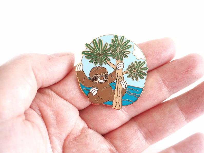 Cute sloth enamel pin. Adorable tree and animal lover gift image 0