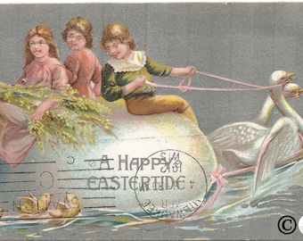 Children Riding on Giant Easter Egg Pulled by Swans Chicks following behind Easter Card Vintage Postcard Over 100 Years Old