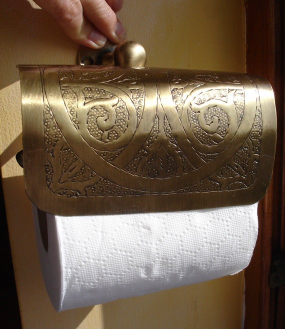Handmade and engraved Moroccan brass toilet paper cover.