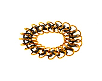Stretchy Chainmail Bracelet With Black Neoprene And Orange Anodized Aluminum