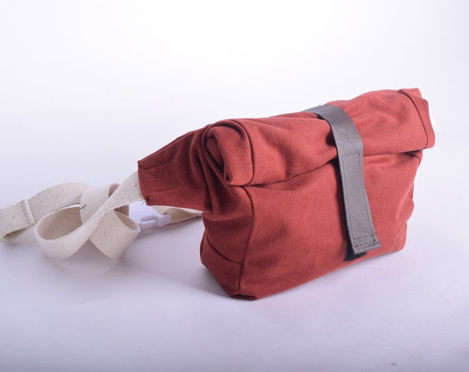Roll top fanny pack or shoulder bag in burnt orange/red with up-cycled leather strap