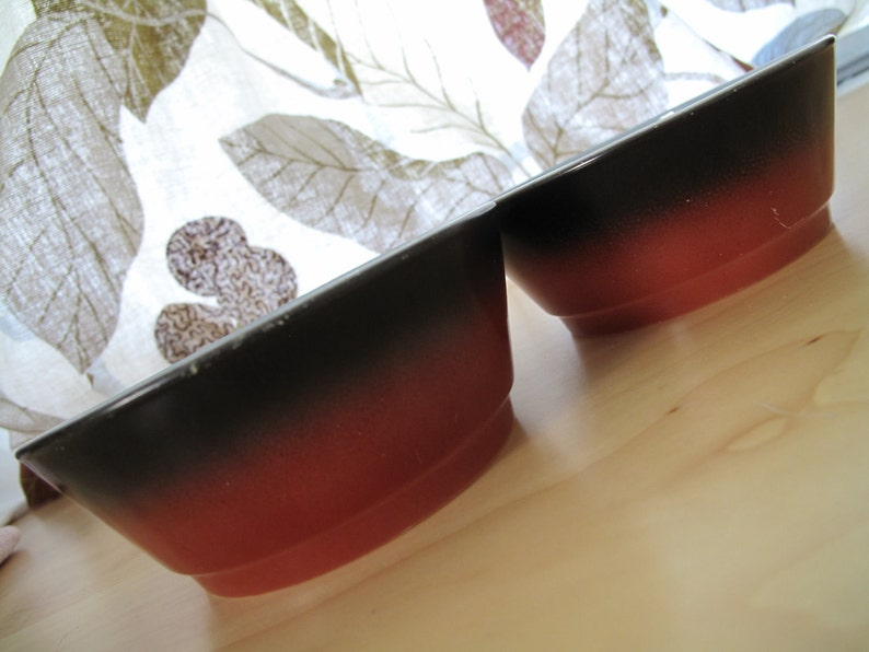pair anchor hocking fire-king red black bowls