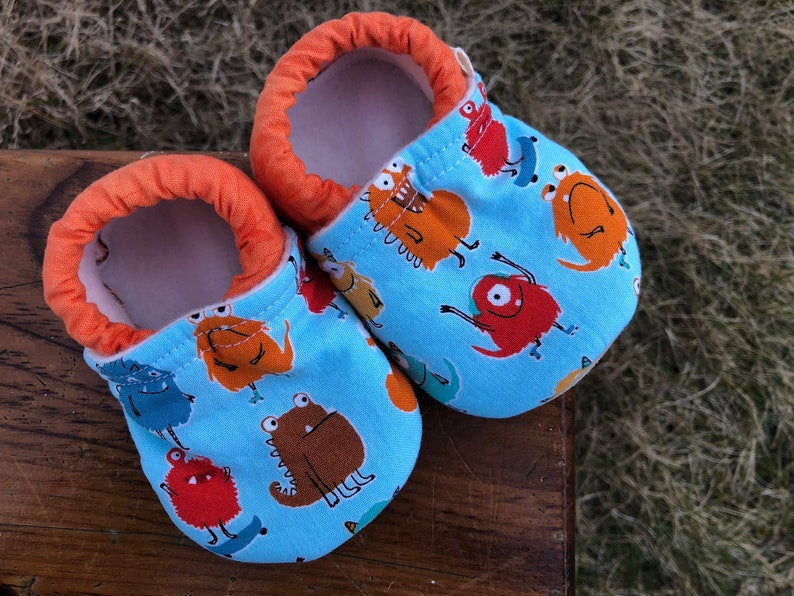 Baby Shoes  Red Orange and Brown Monsters on Blue with image 0