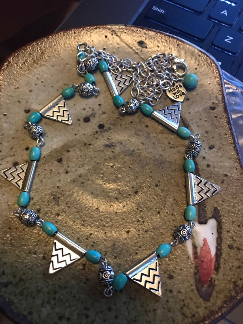 Silver and turquoise colored bead necklace and earrings