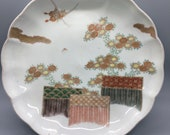 Set of eight rare vintage Japanese Imari scalloped, fluted porcelain plates - a garden scene with chrysanthemums, butterflies, and fences