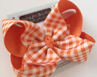 "Pumpkin Gingham hairbow -- choose 4"", 5"" or 6-7"" with optional headband -- pumpkin orange and white checkered gingham"
