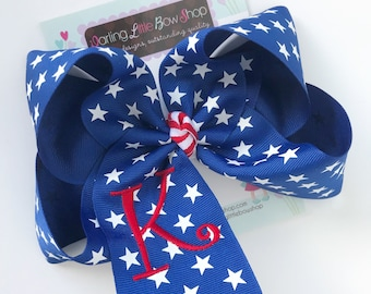 "Monogrammed Bow in royal blue stars ribbon with red initial, choose 4-5"" or 6-7"" bow"