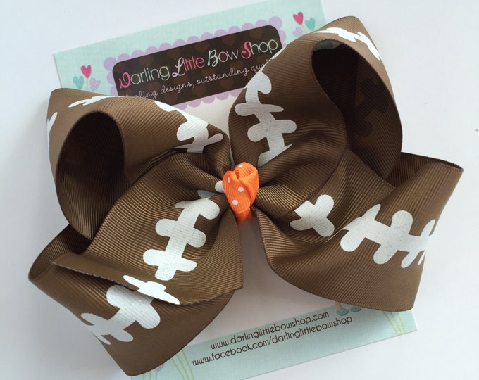 """Football bow, football hairbow -- choose your team color for center, 4-5"""" or 6-7"""" or 8"""" bow"""