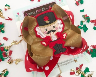 Nutcracker HairBow, Christmas bow in red and gold woth nutcracker center