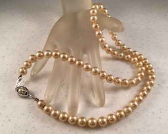 Ivory Pearl Necklace with Sterling Silver Clasp with Small Pearl and Two Rhinestones 22.5 Inches Long Previously 25 Dollars ON SALE