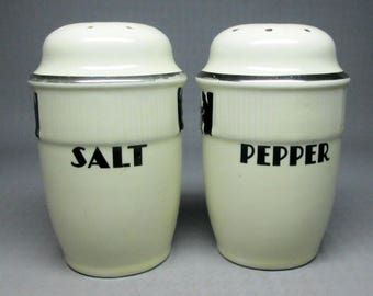 Hall silhouette salt and pepper shakers , the larger size , range top