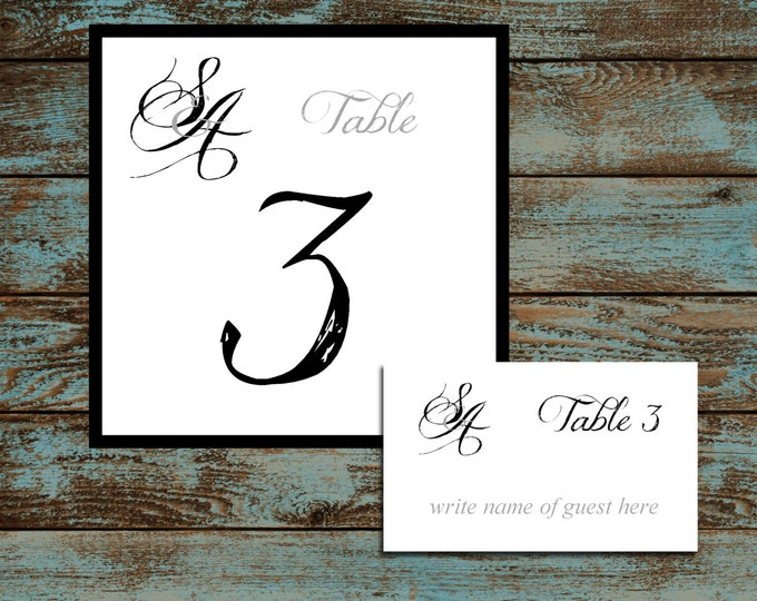 Monogram with Ampersand 25 Table Numbers and 250 place settings.  Personalized & printed Reception guests table decorations.