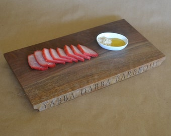 """YABBA DABBA BARBEQUE sale priced is laser-engraved on one edge of this figured Oregon black walnut serving board measuring 14"""" x 7 3/8"""" x 1"""""""