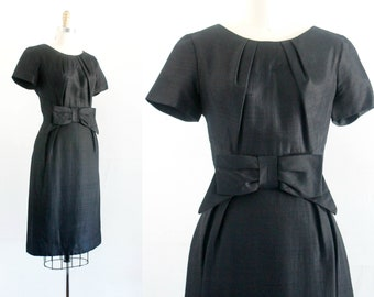"Vintage 1950s black dress .  Francoise  . black silk 50s wiggle dress . black sheath dress with bow . md / 28"" waist"