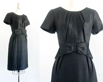 "Vintage 1950s black dress .  Francoise  . black silk 50s wiggle dress . black sheath dress with bow . md / 28"" waist"