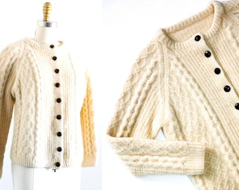 Castle Rock .  60s / 70s white cable knit fisherman sweater . md / lg
