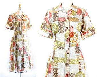 1960s shirtwaist dress // Leo Rising vintage 1960s batik print dress . md