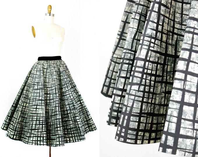 Featured listing image: Paper Doll  . rare 1950s atomic print circle skirt . md / medium