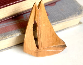 Smooth Sailing // 1950s carved wooden sailboat brooch