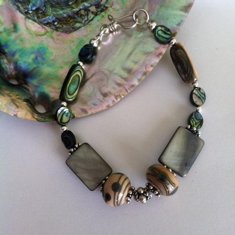 e252da171 Abalone Shell Bracelet Green Paua and Lamp Work Glass Beaded   Etsy
