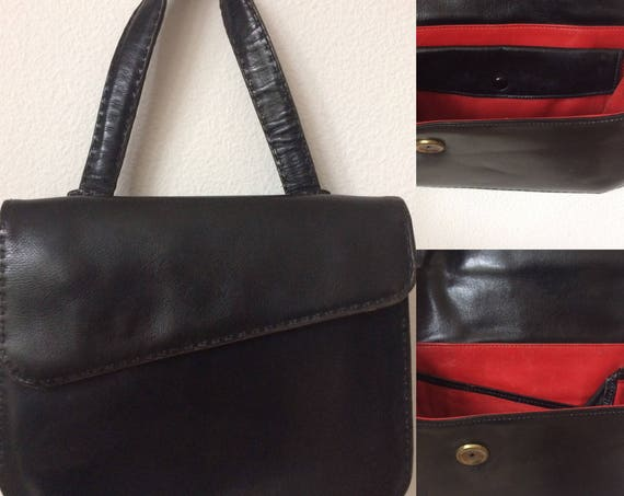 Rare vintage handbag, black leather with red leather lining