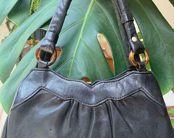 Vintage handbag | fifties purse | black leather | by Karim | bag | top handle | fifties | lucite buckles
