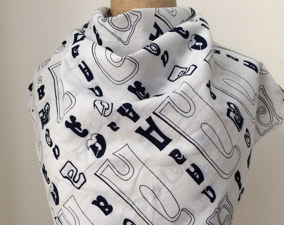Andrea Pfister | vintage scarf | cotton scarf | white and blue | characters | hand rolled | square scarf