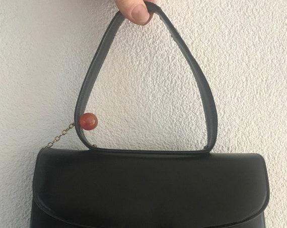 Vintage handbag | black leather | top handle bag | B. Altman & Co. | lucite ball | made in France | eighties