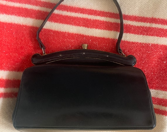 Vintage handbag | black leather | bag | top handle | sixties | gold hardware