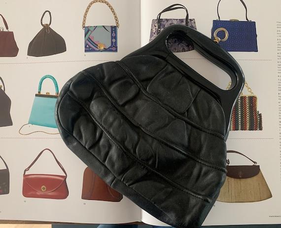 Vintage handbag | black leather | bag | top handle | sixties | plastic handle