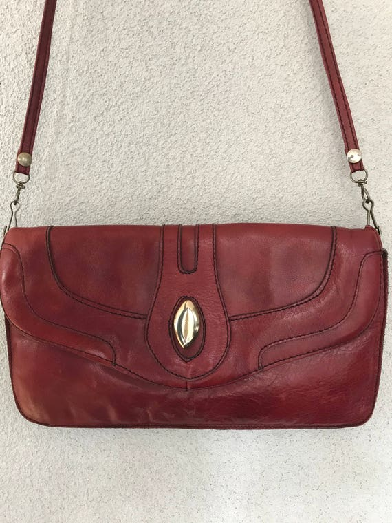 Vintage stylish burgundy or bordeaux red leather shoulder bag, purse or clutch