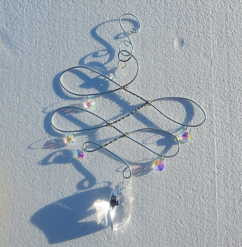 Suncatcher crystals with an abstract wire design hanger.