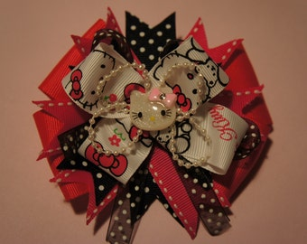 Large stacked  Kitty hair bow.