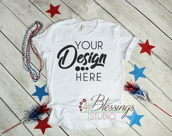 Download Free 4th of July Mockup Bella Canvas 3001 Mock-up Unisex T Shirt Mockup Blank Tee Photo White Patriotic Outfit Background Flat Lay Mockup PSD Template