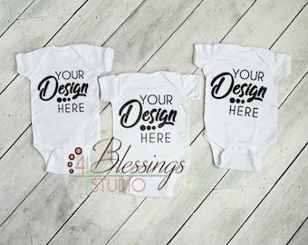 Download Free Three Blank White Baby Bodysuits Shirt Mockup - Triplet Baby Shirt Photo - Blank Bodysuit Mockup - Baby Flat Lay - Rustic - Stock Photo PSD Template