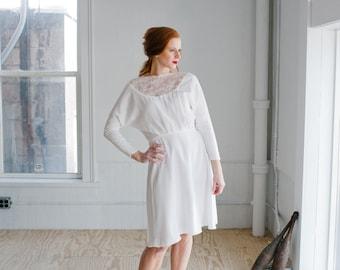 Judith Wedding Dress; Handmade Wedding Dress, delicate high lace neckline on a modern dolman flared dress