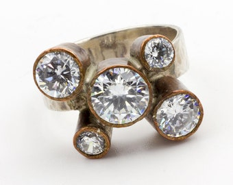 5 Sparkling CZs in Copper Bezels atop a Sterling Ring
