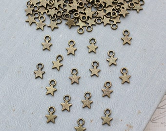 Tiny Star Charms - Antique Bronze OR Antique Gold - 8mm