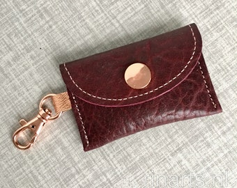 Leather coin case / envelope bag charm in burgundy red and rose gold.  Luxury gift women