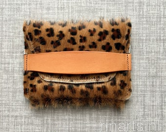 Card holder / pocket wallet in leopard print cow hair with natural bridle leather strap.