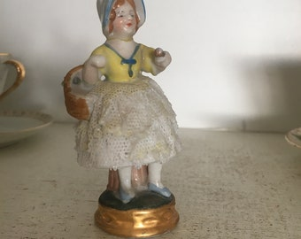 Mini porcelain figurine