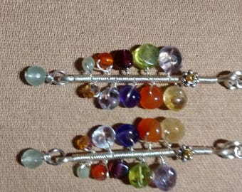 Multi colored semi precious gemstone straight line drops.